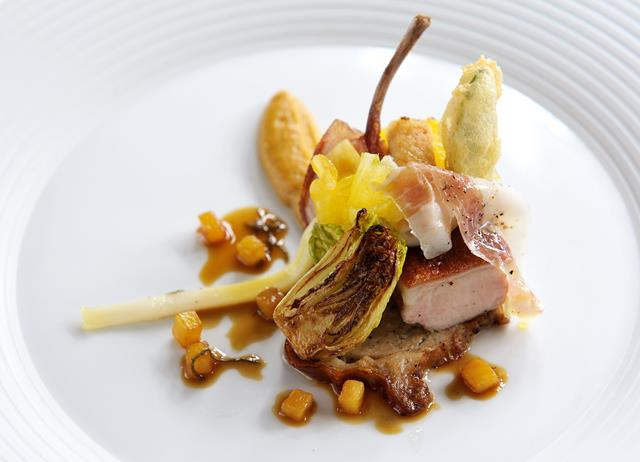 Roast suckling pig with roast pineapple and baby squid