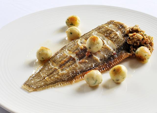 Whole Dover sole with a tarragon and lemon stuffing and potato dumplings