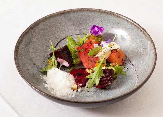 English beetroot with goat's cheese snow, oat biscuits and mizuna