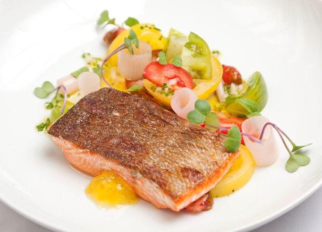 Seared Alaska salmon with heritage tomatoes
