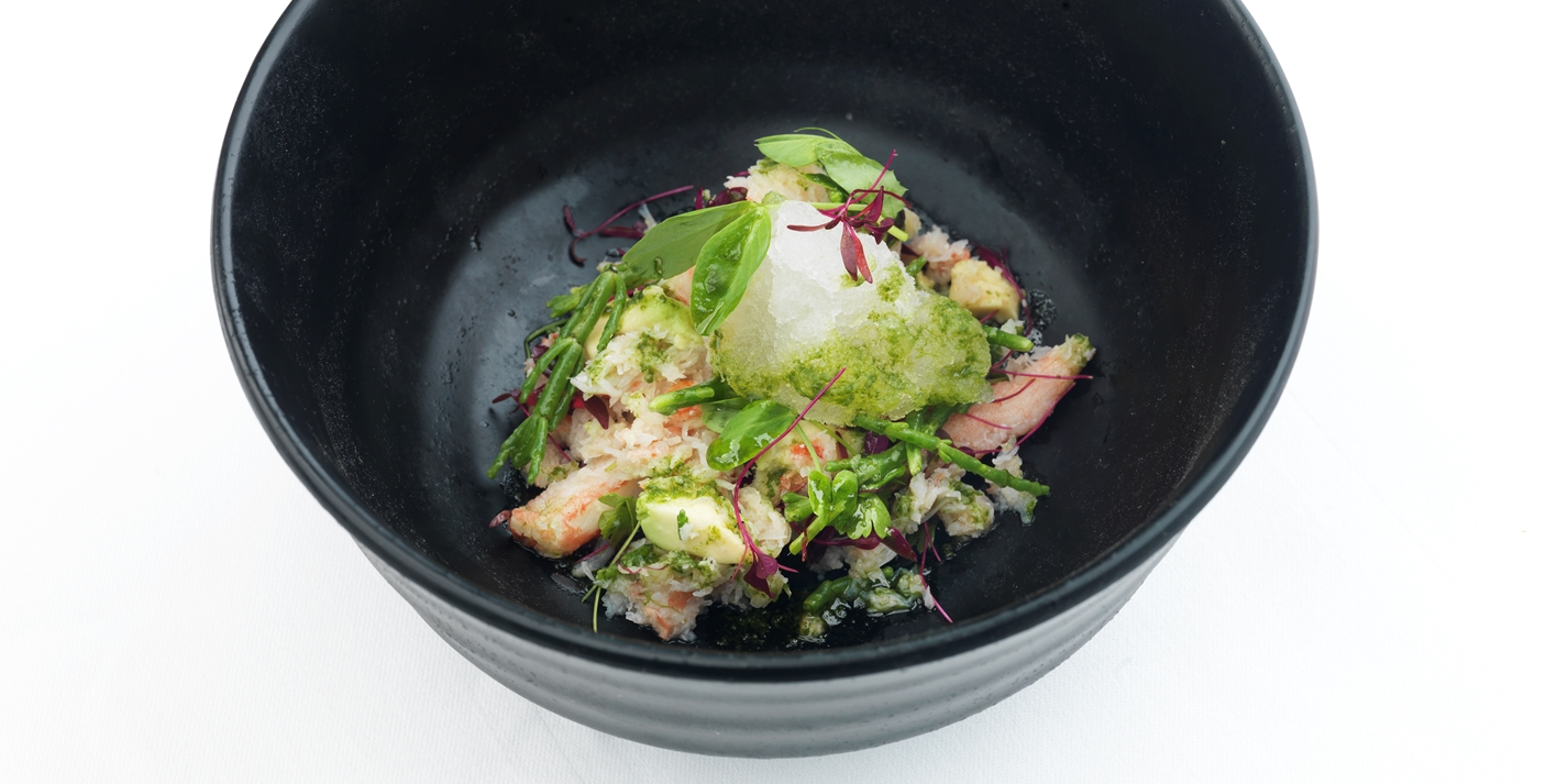 Alaska king crab with micro herb salad and tomato consommé granita
