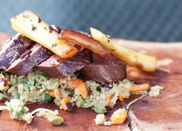 Roast venison loin with parsnips, cardamom-scented quinoa and Medjool dates