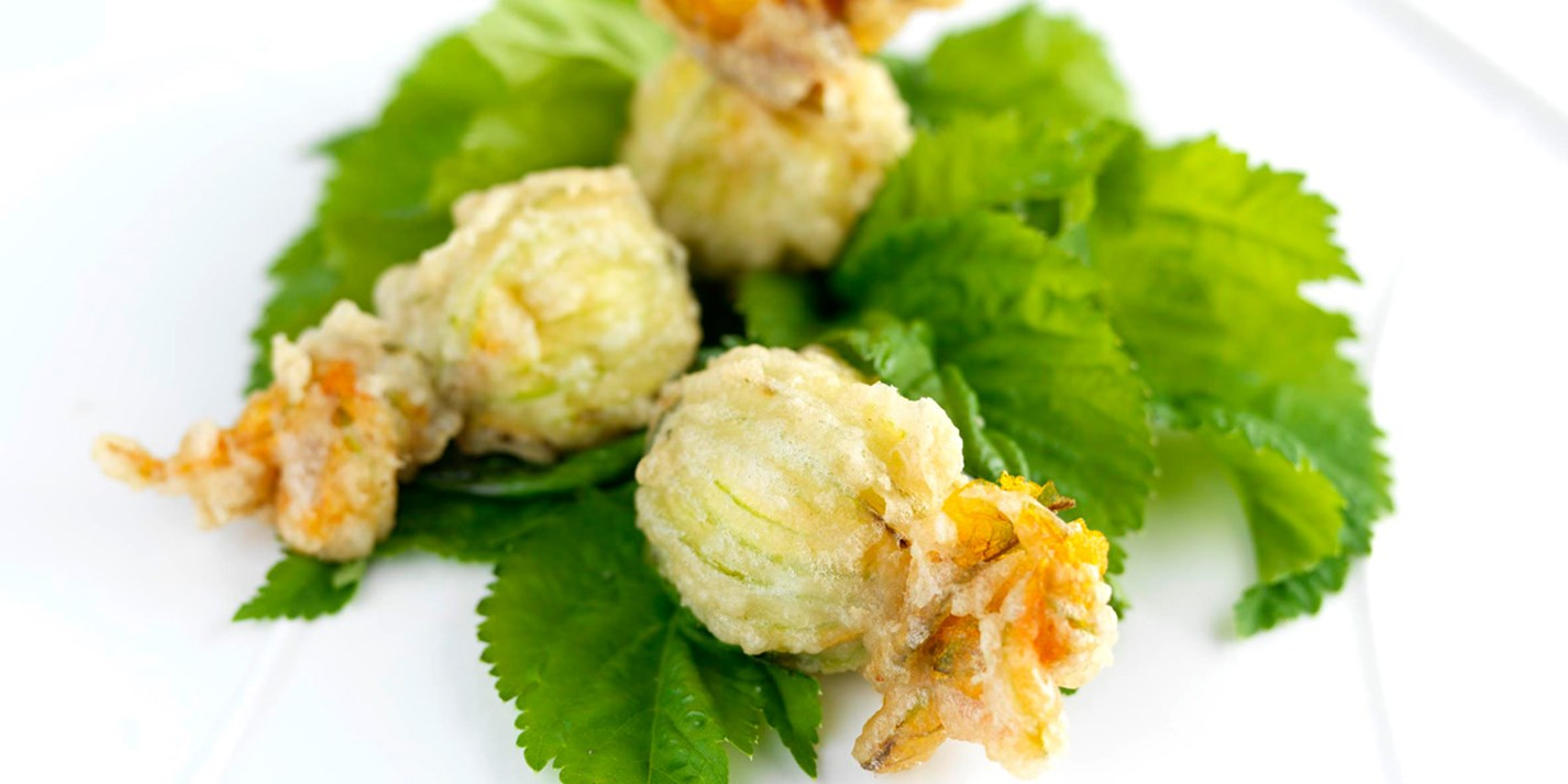 Tempura of stuffed courgette flowers
