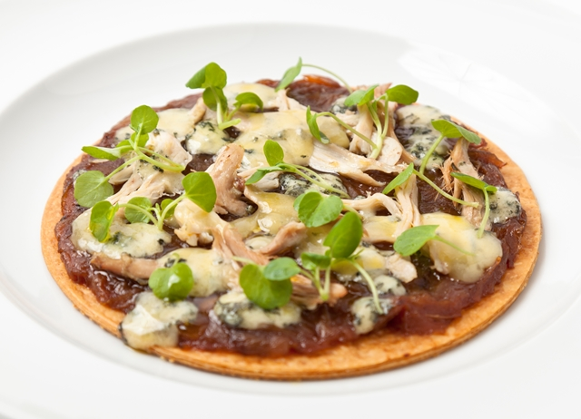 Hot turkey and caramelised onion tart with melting Stilton cheese