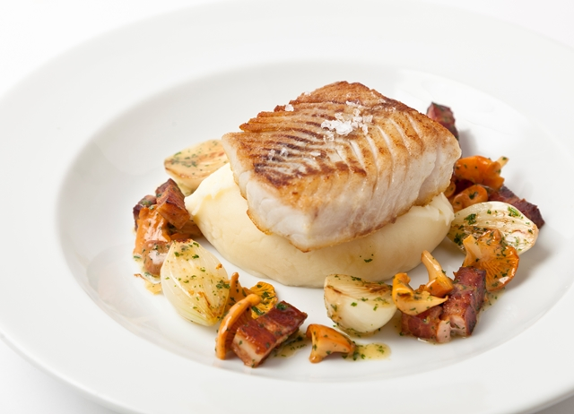 Pan-fried halibut with smoked bacon and girolles