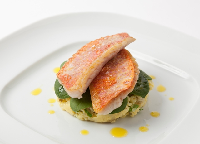 Pan-fried red mullet with baby spinach salad and crushed Caesar new potatoes