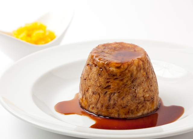 Steamed mutton and onion suet pudding with crushed swede