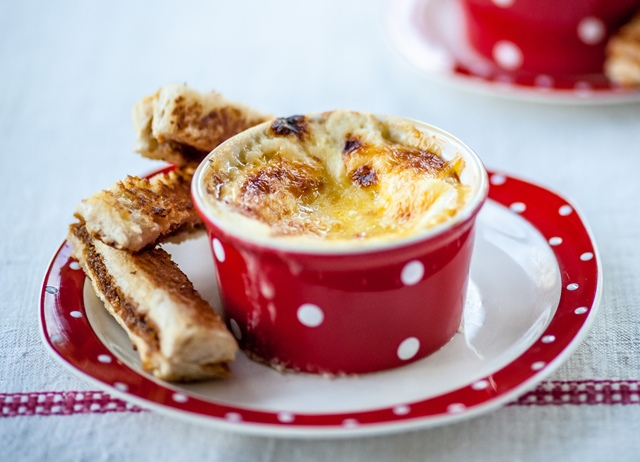 Cheesy baked eggs with Marmite soldiers