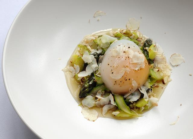 Slow-cooked duck egg with duck confit, asparagus and cobnuts