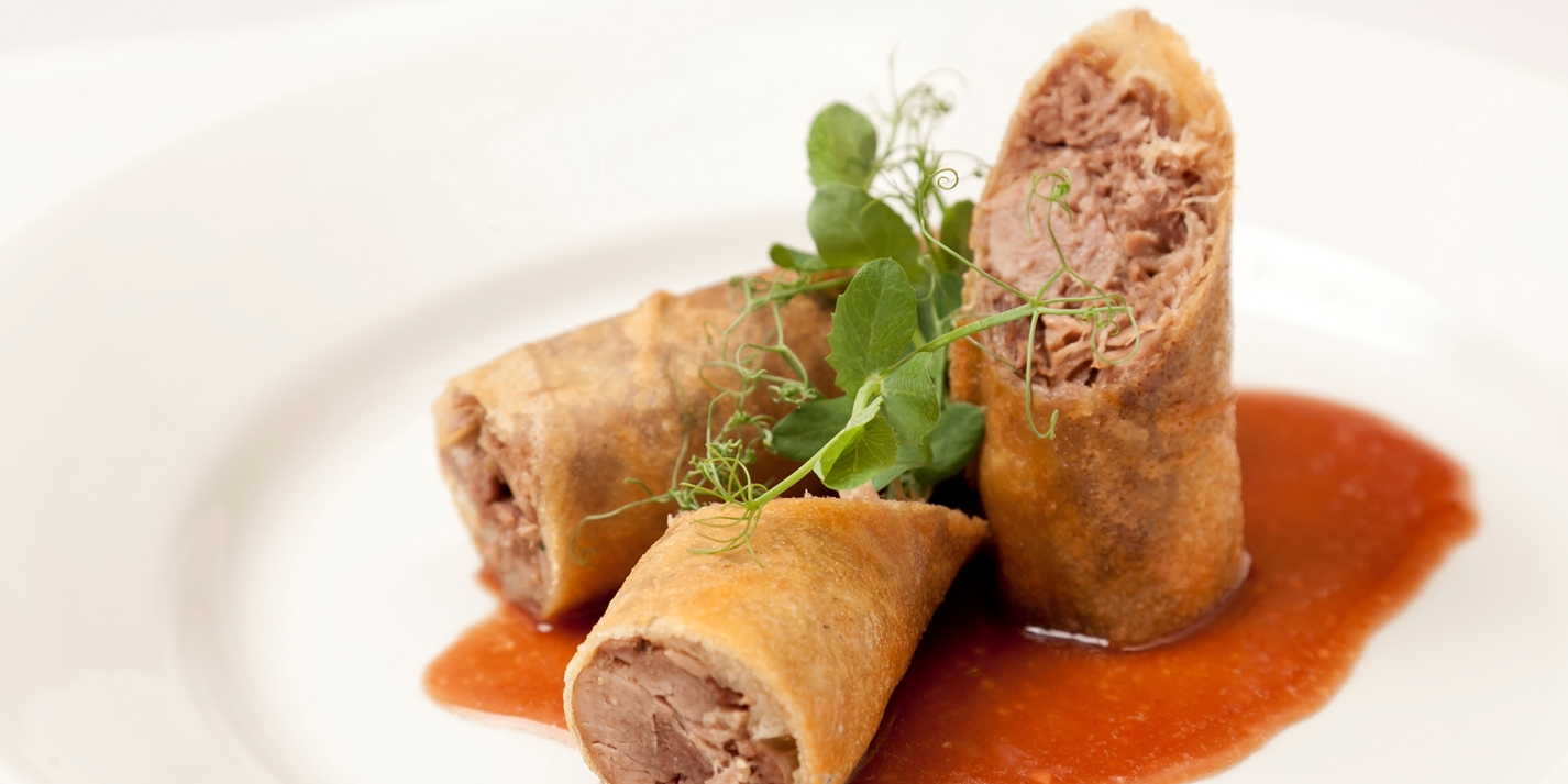 Crispy duck spring rolls with barbecue sauce
