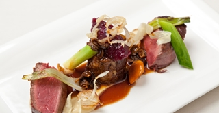 Fillet of beef with braised oxtail, textures of onion and morel Madeira sauce