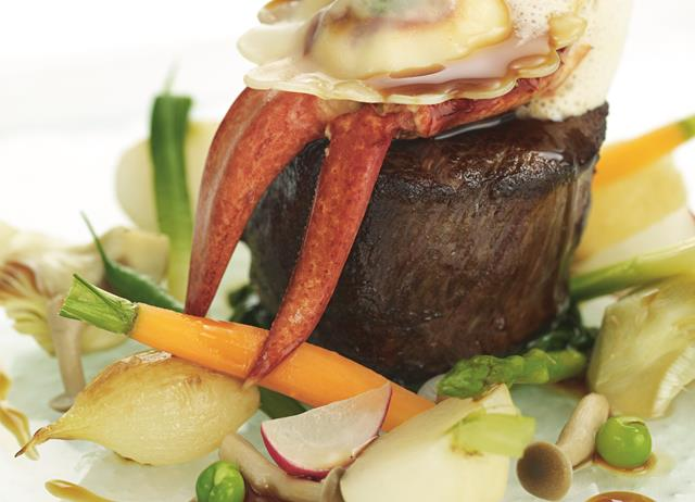 Jersey beef fillet with St Ouen's Bay lobster ravioli and summer vegetables