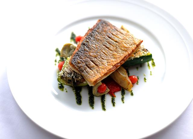 Griddled South Coast sea bass with provençal vegetables and basil oil