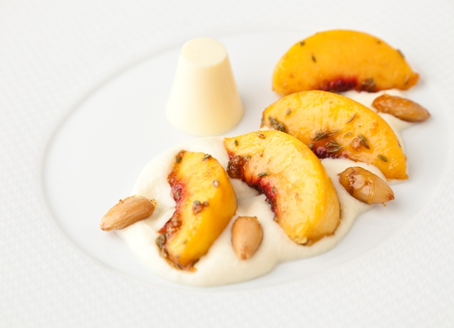 Grilled peaches, white chocolate rabdi and cardamom panna cotta
