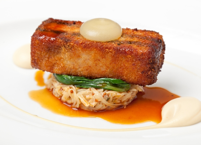 Crispy pork belly with black pudding, celeriac remoulade and apple purée