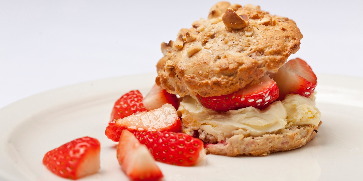 Hazelnut and tonka bean scones with Sweet Eve strawberries and clotted cream