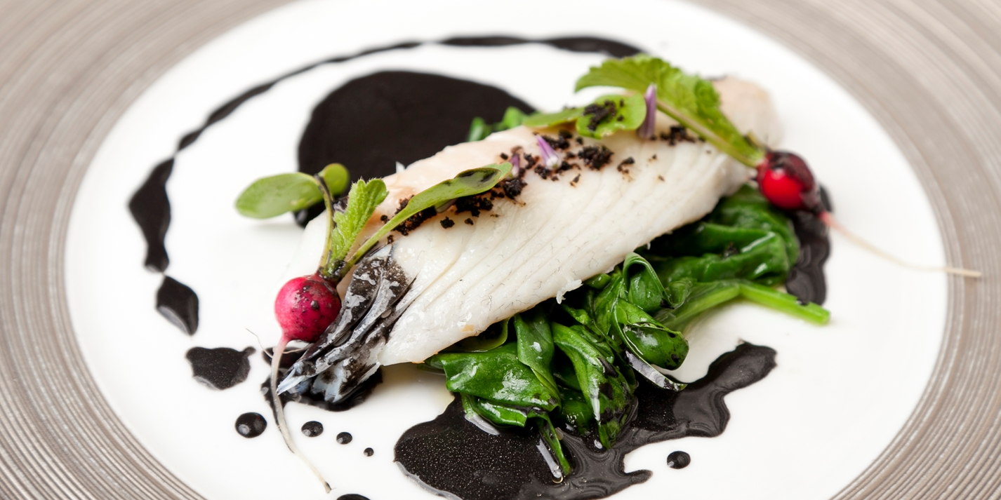 Baked bream with wilted spinach, radish and nero sauce
