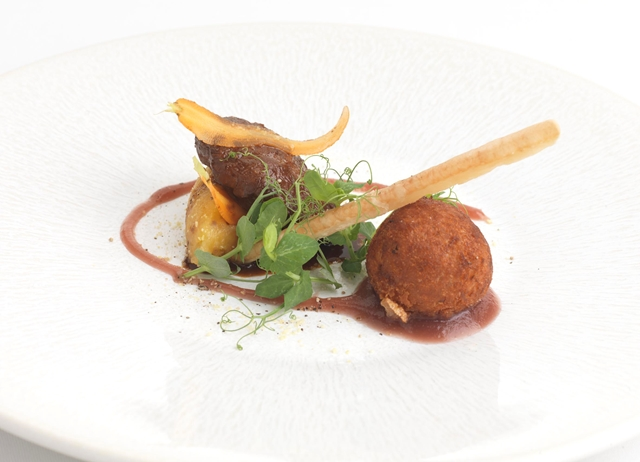 Pork cheek with crispy ham hock bon bon, crushed swede and mustard apple compote