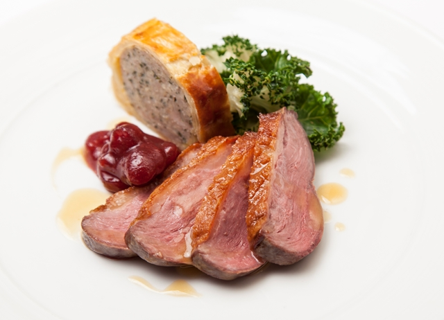 Goose breast with goose leg sausage roll, kale and cranberry relish by Marcus Wareing