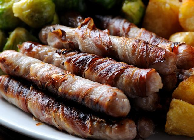 Chipolatas wrapped in streaky bacon