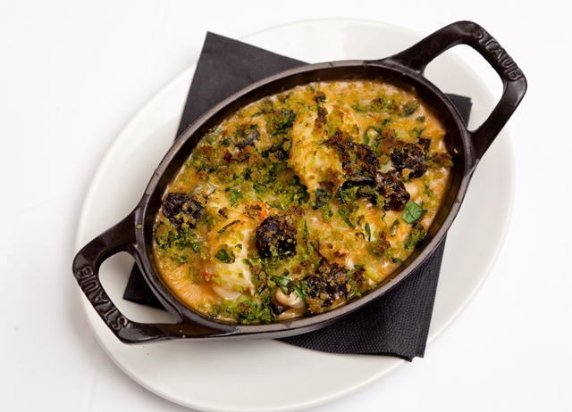 Black pudding, scampi and white bean crumble with wild garlic crust