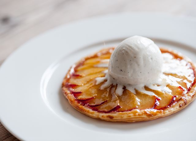 Plum tart and vanilla ice cream