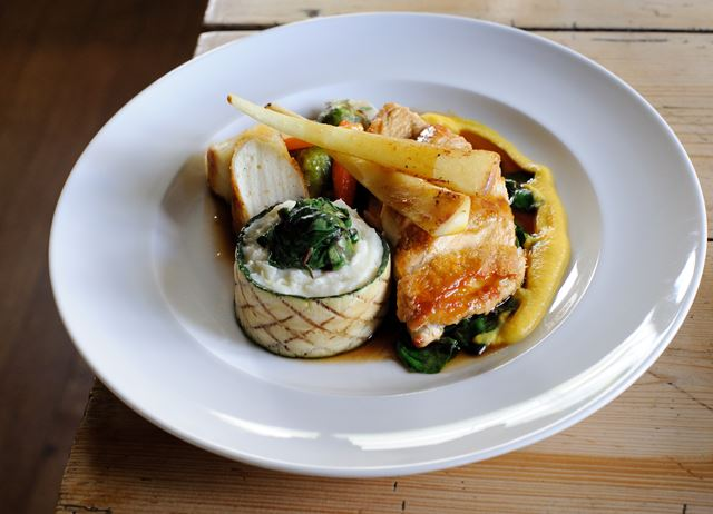 Suprême of chicken with truffled sausage, potato purée with leeks, roasted vegetables and tarragon jus