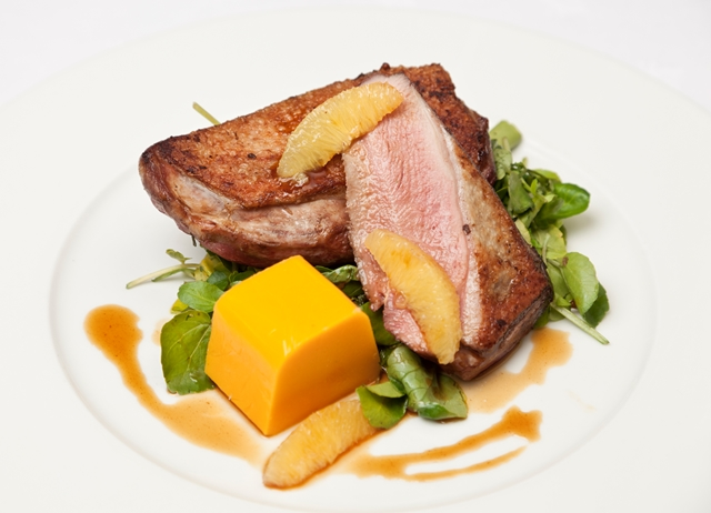 Roast duck crowns with wilted watercress, butternut squash mousse and bigarade sauce