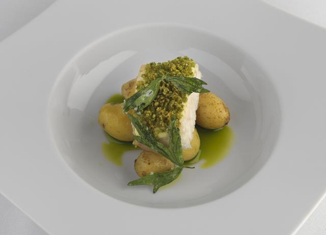 Soft lovage-crusted brill with new potatoes