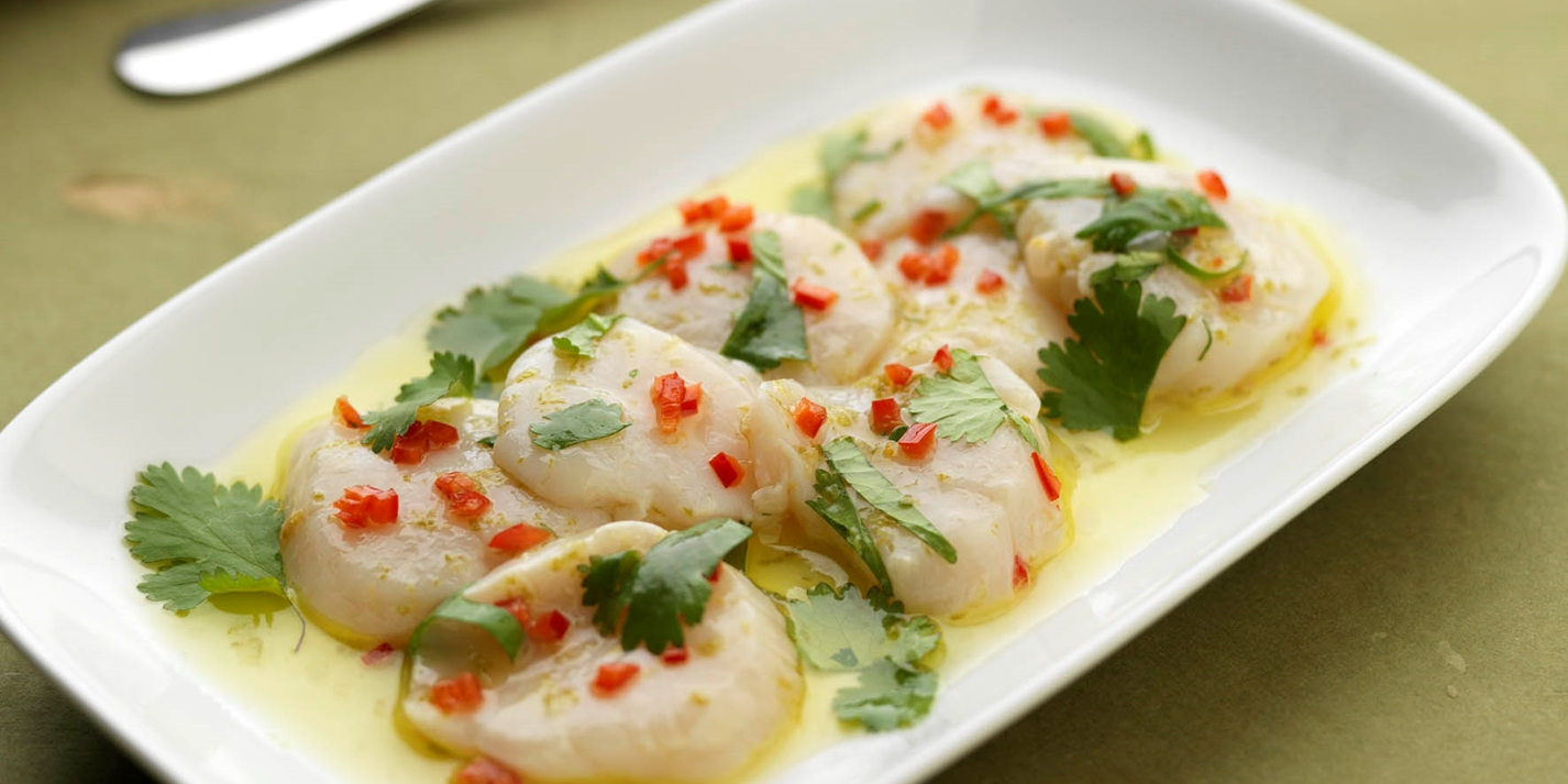 Scallop carpaccio with basil, coriander, mint and lime