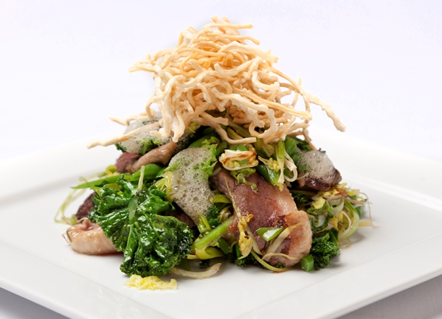 Honey marinated duck breast with sautéed greens and crispy noodles