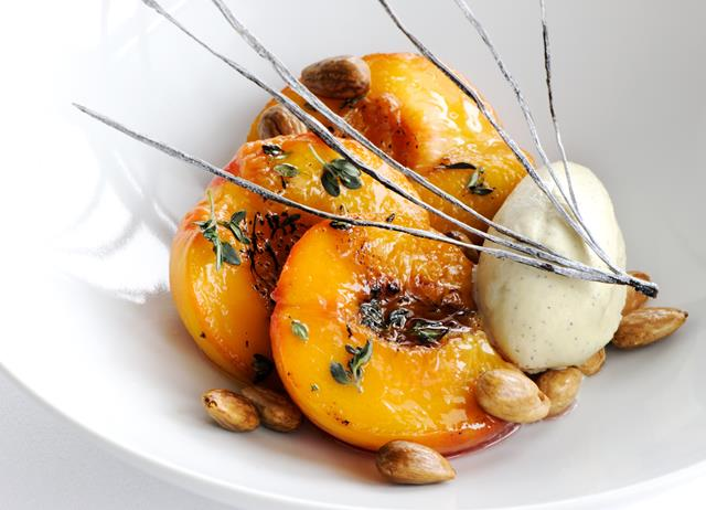 Roast peaches with lemon thyme, vanilla ice cream and toasted almonds