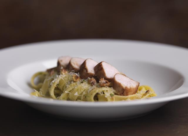 Loin of rabbit with fettuccine, prosciutto and roasted hazelnuts