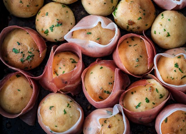 Garlic dough balls wrapped in prosciutto