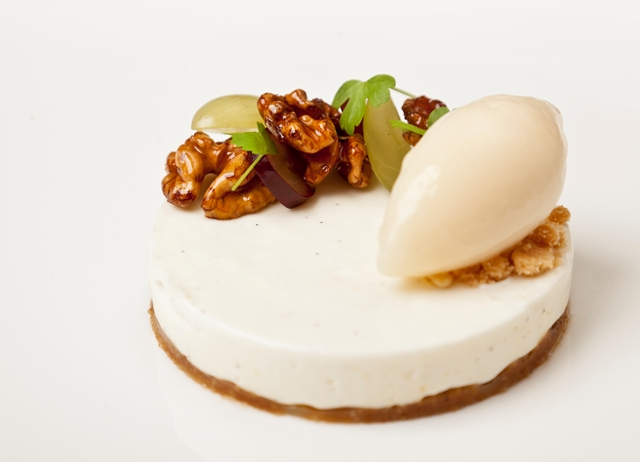 Vanilla cheesecake with candied walnuts, grapes and apple sorbet