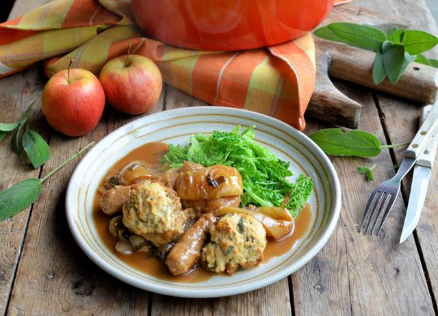 Sausage and apple casserole with herb-crusted dumplings