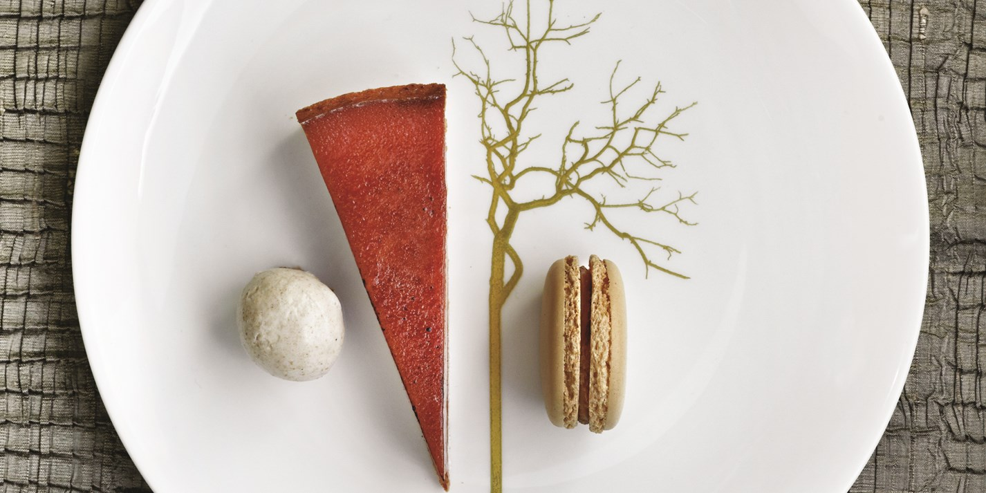 Salted caramel tart with praline macaroons, praline cream and ginger and vanilla ice cream