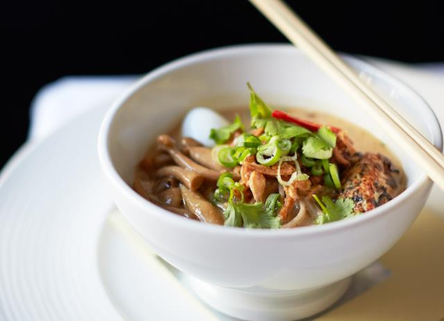 Duck and coconut laksa with grilled sweetcorn, soba noodles, squid and coriander