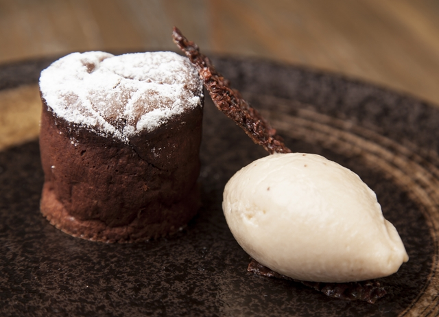 Hot chocolate fondant with brakspear black stout ice cream and cocoa ...