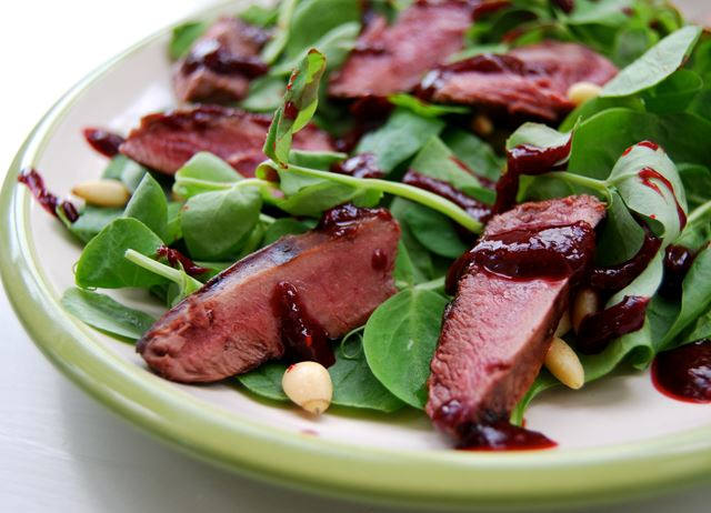 Wood pigeon salad with raspberry balsamic reduction