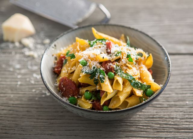imageGarganelli pasta with chorizo and peas