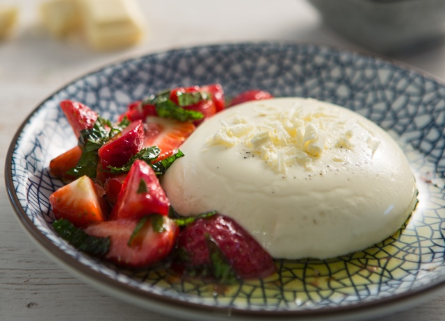 White chocolate panna cotta with lemon, mint and olive oil strawberriesimage