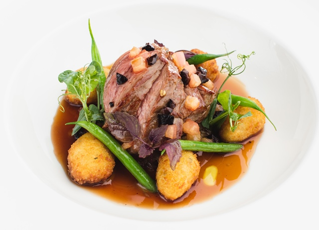 Roasted lamb rump, potato gnocchi, fine beans, cockle and black olive jus