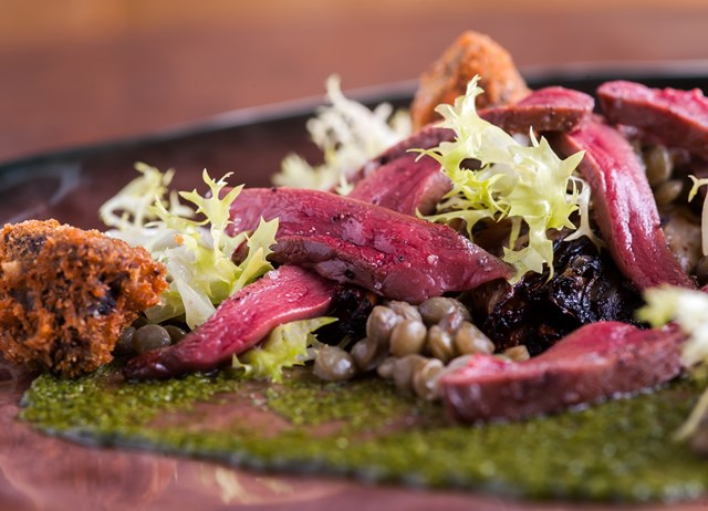 Wood pigeon with salsa verde and black pudding beignets