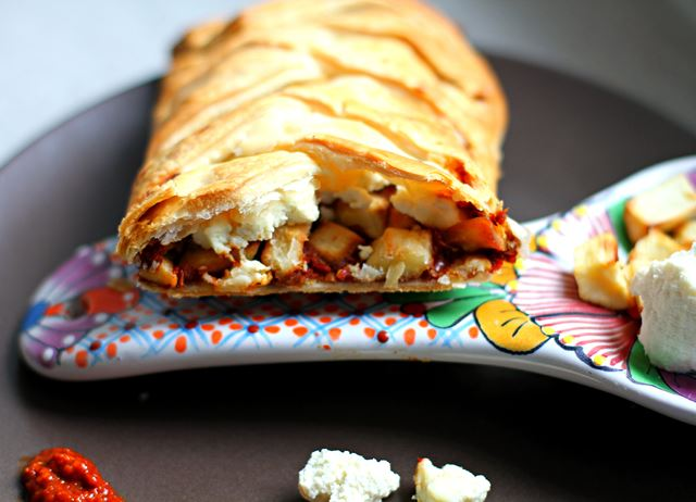 Rose harissa, parsnip and paneer puff pastry plait