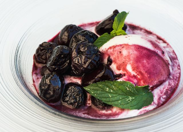 Poached cherries in spiced red wine syrup