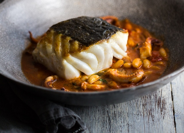 Pan-fried skrei with cannellini beans and squid