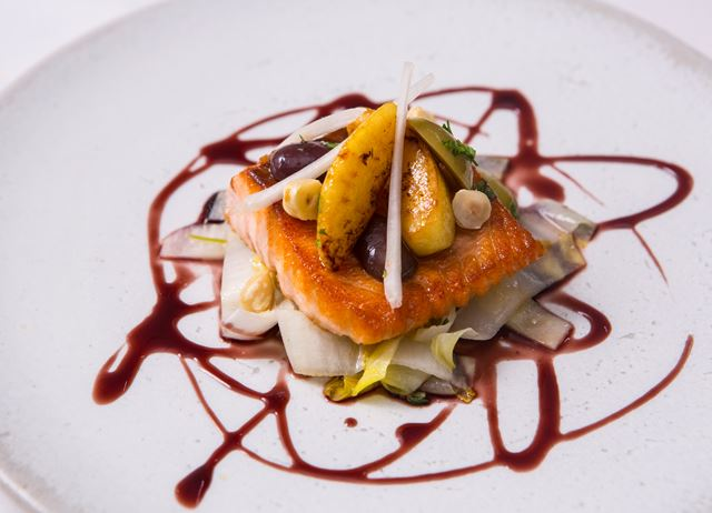 Cedar planked salmon with endive, apple and olives